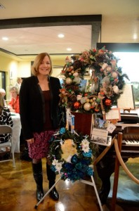 Local author Laura Kepner poses near her wreath (bottom). Credit: Janet Hooper