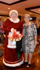 Mattie Williams director Janet Hooper poses with Mrs. Claus. Credit: Janet Hooper