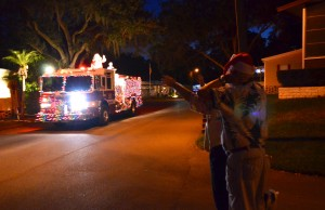 Briar Creek residents wave to Santa aboard a SHFD fire engine Friday night.