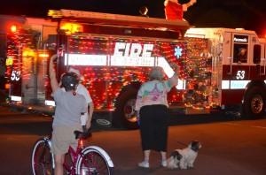 Briar Creek residents wave at Santa riding a SHFD fire truck Friday night.