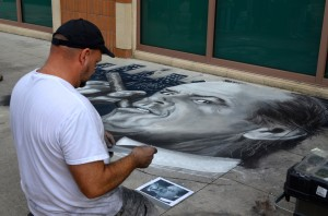 West Palm Beach based artist Dave Lepore puts the finishing touches on his prize-winning piece.