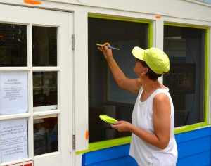 Local artist Stacy Roth works on the new paint scheme for the Harborita Cantina.