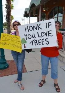 Betty Lou Douglas (R) protests the tree removal at the Safety Harbor Spa on Thursday.