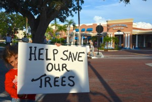 Six-year-old Sophia Capello holds a 'save the trees' sign outside the Safety Harbor Spa on Thursday.