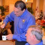 Oldsmar Mayor Doug Bevis serves coffee at the 2013 Mayor's Breakfast event.