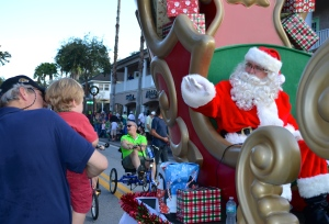 Santa waves to a young boy during the 2013 Safety Harbor Holiday Parade.