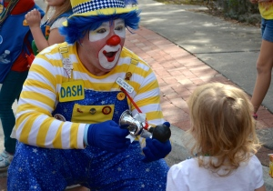 Young Meyah Smith has fun with a clown at the Safety Harbor holiday parade.