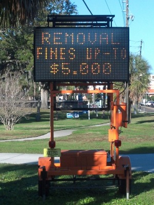 tree removal fine sign