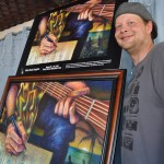 Songfest poster artist  Jesse Adams poses with his work. Credit: Safety Harbor Art and Music Center.