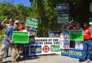 Andy Zodrow and Janet Hooper (front left) stand with their supprters outside the Safety Harbor Public Library on Election Day 2015.
