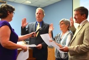 Commissioners Andy Zodrow, Janet Hooper and Cliff Merz were sworn in on Monday night.