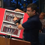 Steve Chickos shows pictures of sign code violations to the Safety Harbor City Commission.