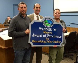 Crooked Thumb Brewery co-founders Kip Kelly (l) and Travis Kruger (r) pose with Safety Harbor Mayor Andy Steingold after receiving the Mayors Award of Excellence in January 2016.