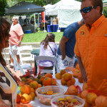 Dempsey lee of Florida Citrus Country talks to a shopper at Safety Harbor's Farmer's Market ion Main last Sunday.