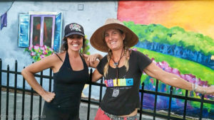 Heather Richardson (R) and Beth Warmath pose in front of their latest mural in downtown Safety Harbor.