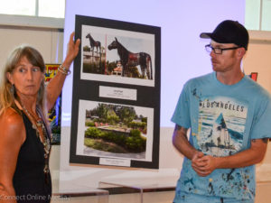 Artists Heather Richardson and Derek Donelly display one of the public art proposals on Monday night.