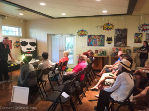 Safety Harbor artist Dino Kotopoulis presents his public art project proposal at the Safety harbor Museum and Cultural Center on Monday night.