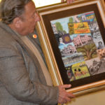 Artist Stu Dwork presents his Safety Harbor centennial themed painting on Monday night.