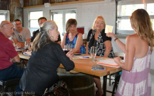 Mercedes Ofalt (l) leads a discussion at the latest MOSH board meeting at Crooked Thumb Brewery on Monday.