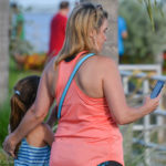 A mother and daughter play Pokemon GO at the Safety Harbor marina on Monday.