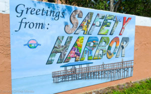"A new ""postcard"" style mural by Dunedin artist Matt Sunderman was recently installed at the Safety Harbor Marina."