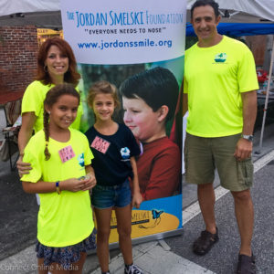 Safety Harbor City Commissioner Carlos Diaz, his wife, Lori and their daughter, Isabella, campaign on behalf of the Jordan Smelski Foundation with a family friend last Third Friday.