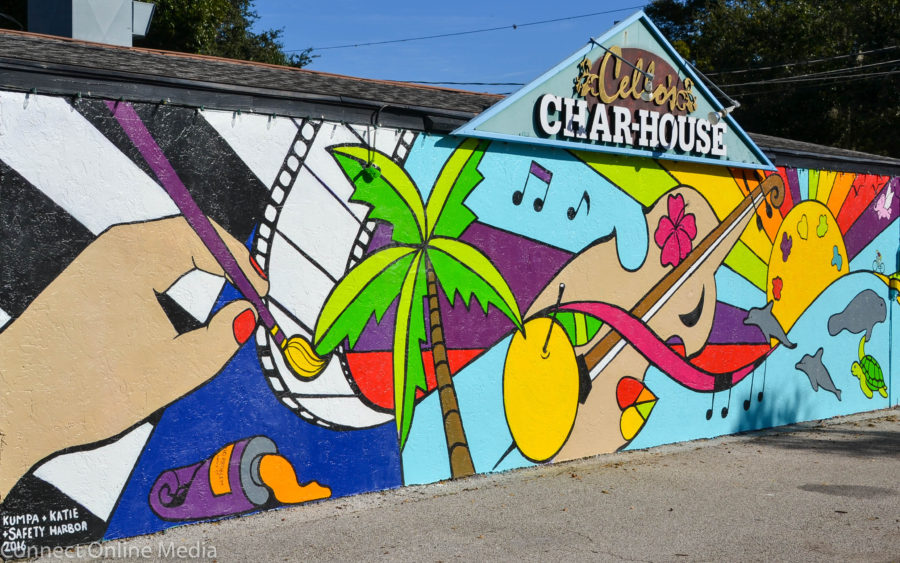 Artists Kumpa Tawornprom and Katie Bush led this community mural project, which helped breathe new life into the iconic Cello's Charhouse mural.