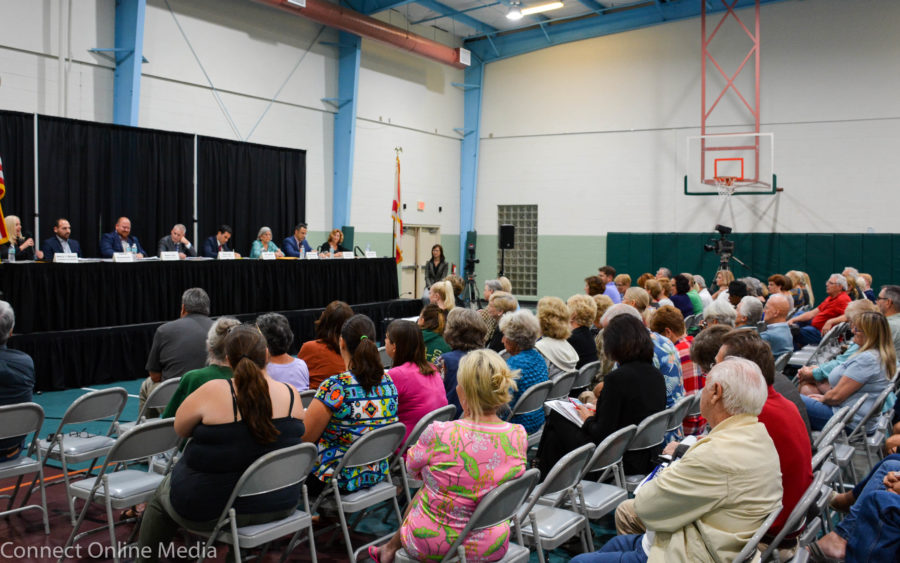 Seat 1 candidate Nancy Besore (l) answers a question at the candidate forum on Thursday night
