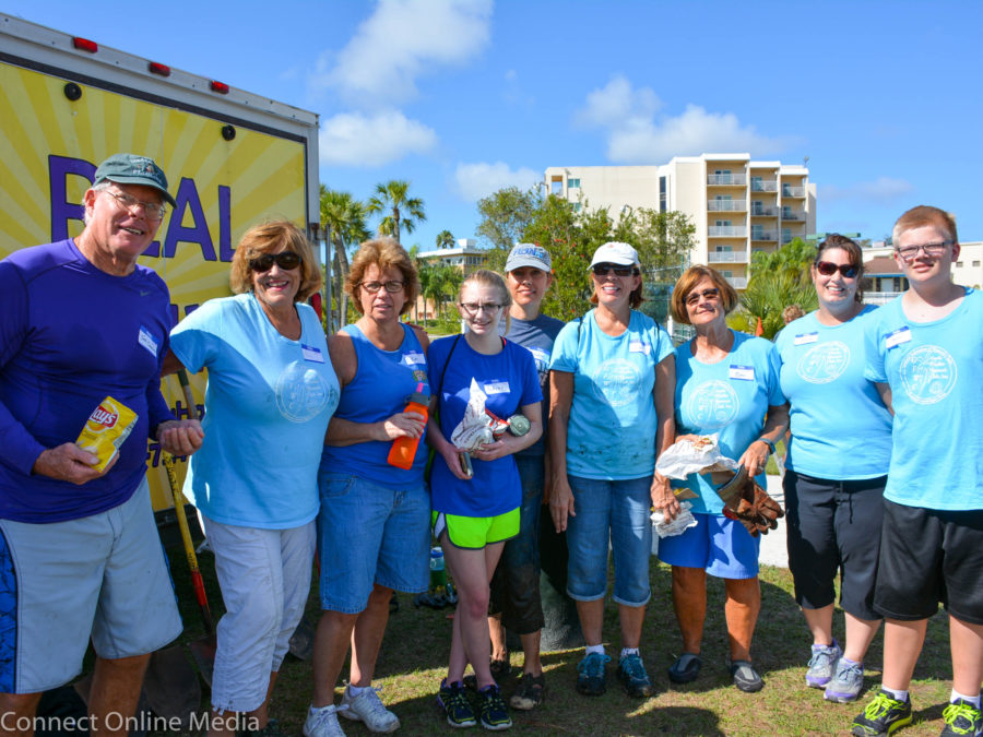 Volunteers from several community organizations, including former Countryside High School marine biology teacher Patti Boylan (second from left) pose at the Safety Harbor Waterfront Park planting project on Saturday, Feb. 26, 2017.
