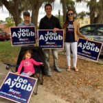 Joe Ayoub and his supporters stumping for votes at the Safety Harbor Library on Tuesday.