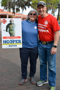 Janet Hooper and Safety Harbor firefighter Charles Russell campaign outside the library on Tuesday.