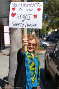 Signs showing support for the Safety Harbor post office were seen during the meeting on Wednesday.