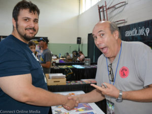 George Lowe, a.k.a. Space Ghost (r) poses with a fan during FusionCon 3 at the Safety Harbor Community Center on Saturday, April 29, 2017.